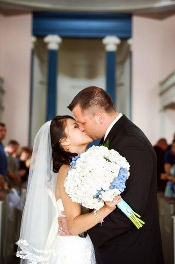 Bride and Groom Kiss!  Photo: Laura Matthews Photography
