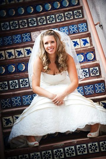 Bride Resting on Mexican Tiled Staircase at Lodge on the Desert