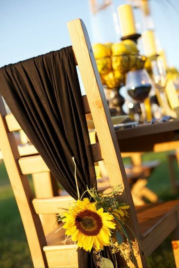 Rustic chair with sunflower decoration