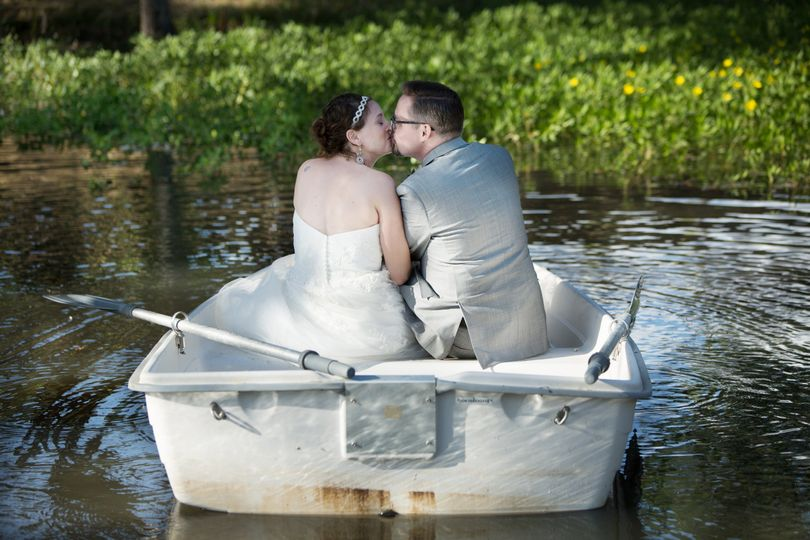 Bride & Groom in a row boat