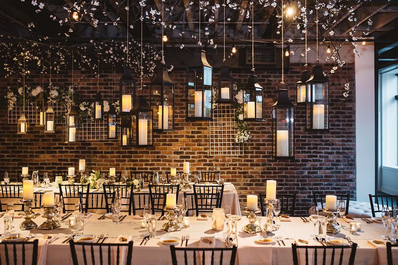 Reception with garden lanterns, banquet tables, photo: Lawrence Braun, A Couple of Dudes Photography