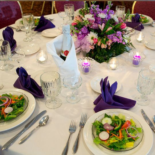 Table setup with centerpiece and wine bottle