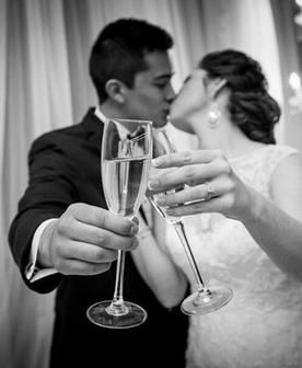 Couple kissing and champagne toast