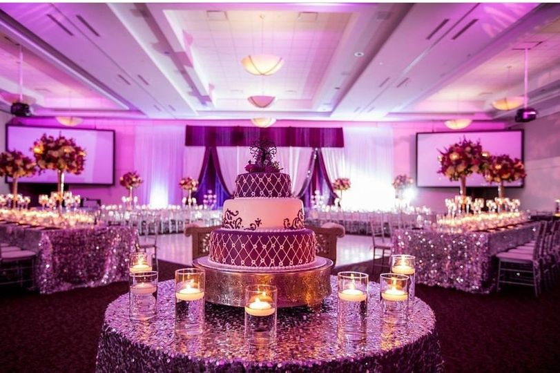 Wedding cake setup with candles