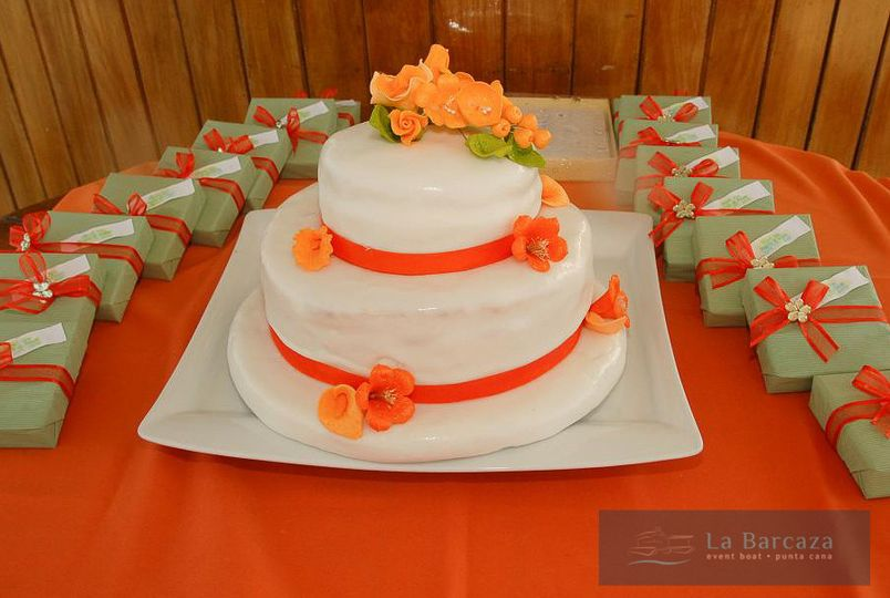 Simple white wedding cake with orange flowers