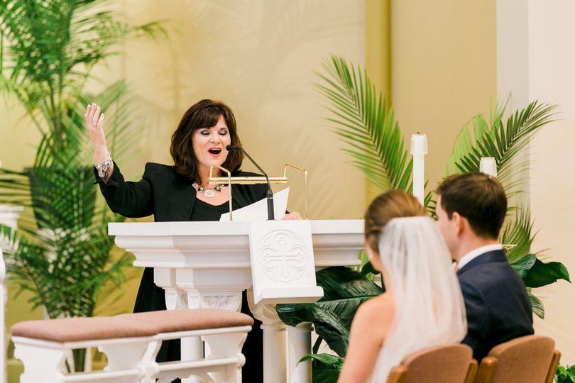 Stella singing at ceremony