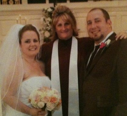 The officiant with the couple