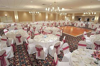 A white & fuschia themed wedding reception in our Crown Ballroom in April 2008.