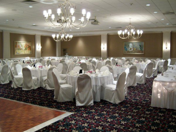 A white & ivory themed wedding with ivory striped chair covers in October 2008.