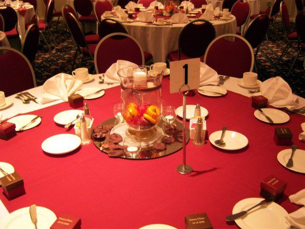 Mirrors, votives, number stands, and place settings come courtesy of the Holiday Inn Downtown.