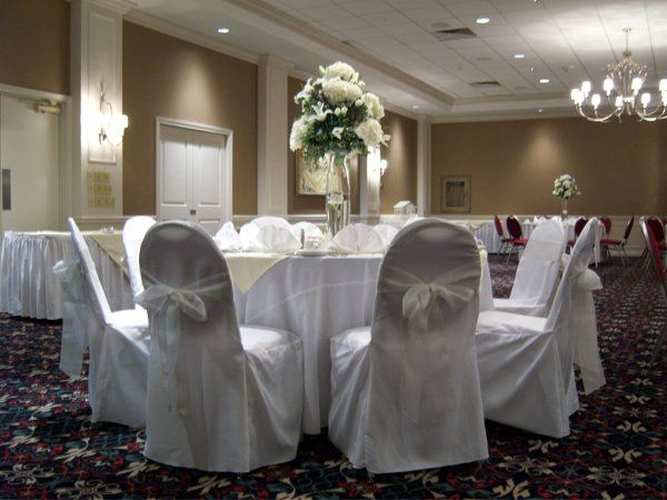 An intimate ivory & white themed wedding for 60 guests in October 2008.