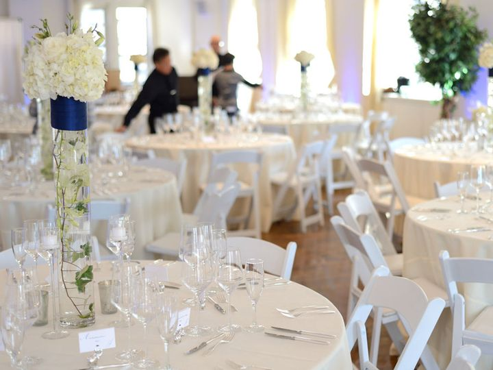 Pure Glassware, White Folding Chairs and pops of blue complete the look of this wedding at Midtown...