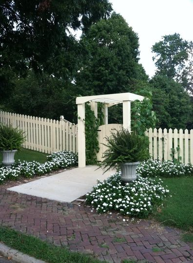 Arbor entry to terraced lawn