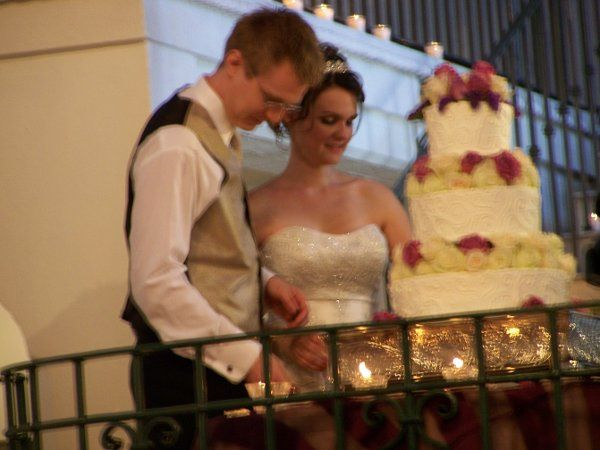 Husband and Wife cut their first piece of cake as husband and wife... yum, yum!