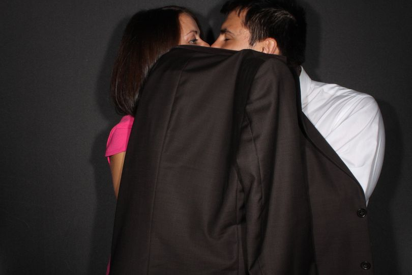 Couple covered kiss
