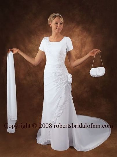6000 Gown   Made from matte duchess bridal satin and pictured in the beautiful gold color, this...