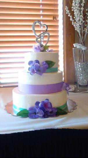 3-tier wedding cake with purple details