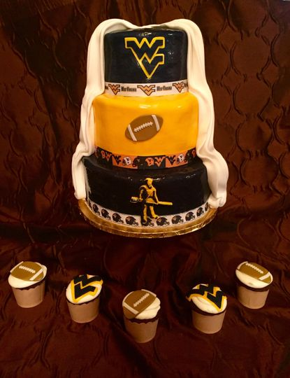 Sport themed wedding cake and cupcakes