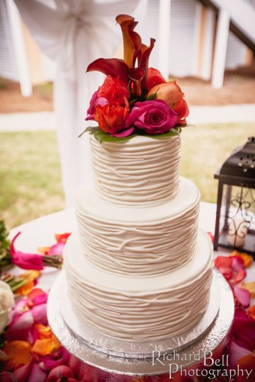 Textured white cake with flower topper