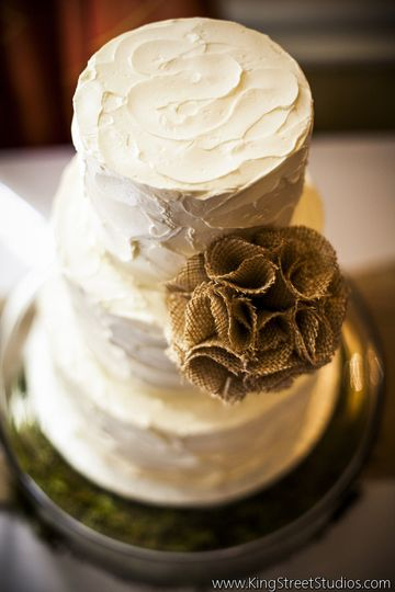 Textured white cake with brown flower