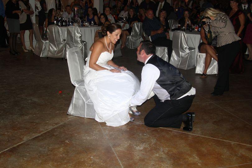 Groom removing the bride's garter