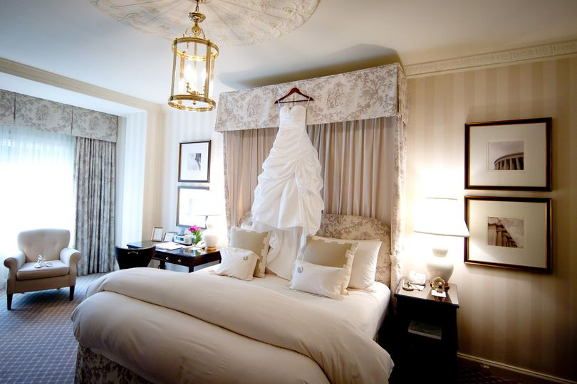 Wedding gown hanging in room