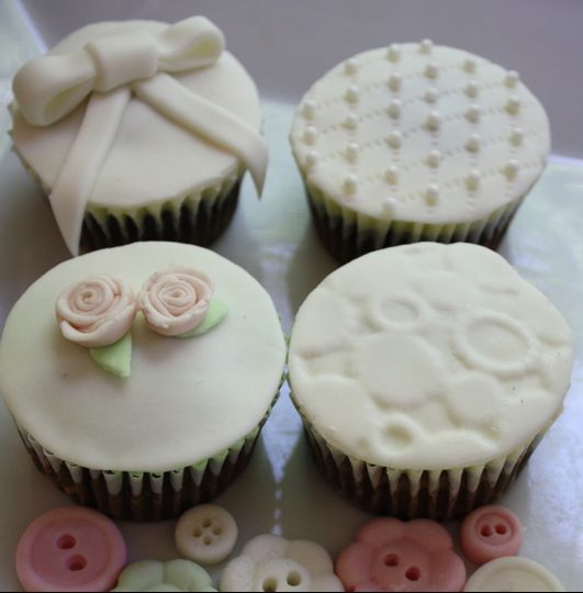 tiniest empire cupcakes wedding cake tallahassee fl weddingwire. Black Bedroom Furniture Sets. Home Design Ideas