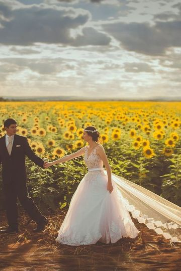 Bride and groom at a sunflower field
