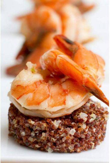Sauteed shrimp atop quinoa.