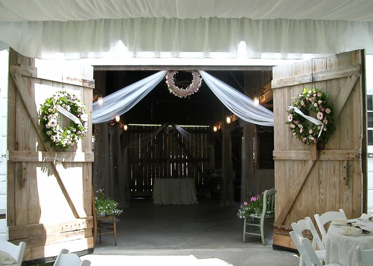 decorated barn door entrance from tent