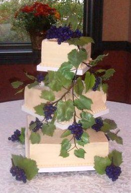 Perfect for the Vineyard wedding.  Square cake adorned with hand made sugar grapes, vines and...