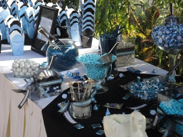 blue and black candy buffet.  pictures shows candy in glass dishes with scoops