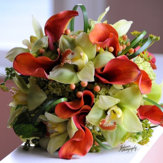 Green orchids and orange calla lilies for a dramatic summer bouquet
