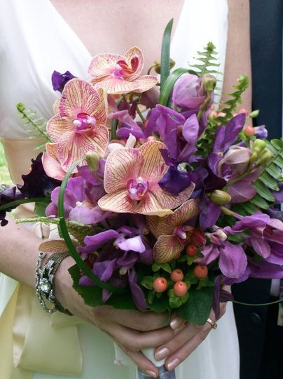 Colorful orchid bouquet with ferns