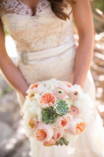 Romantic bridal bouquet with peach garden roses, succulents ranunculus and peony