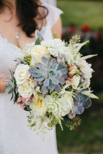 Rustic and textural bridal bouquet with succulents. Perfect for this bride's garden wedding in...