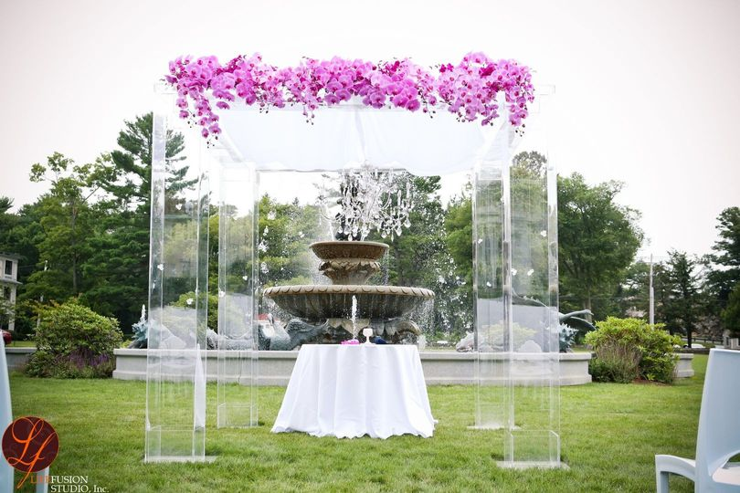 Clear acrylic chuppah with chandelier  and cascading phalaenopsis orchids