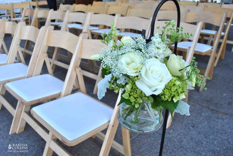 Shepherd's hook with summer flowers for ceremony aisle