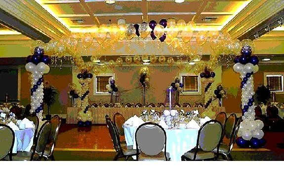 Dance Floor Decor' with Head table Decor' with up to 15 table centerpieces at $600.00 substitutions...