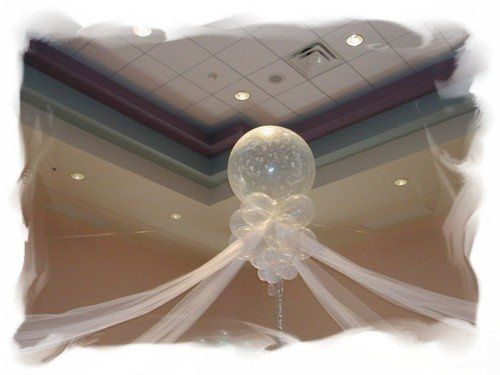 Instead of balloon arches utilize a enchanted  drape of linen. .
