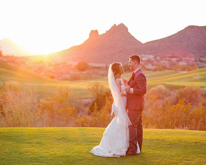 bride and groomdancingsunset