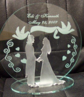 This is the perfect cake topper or table embellishment for a lovely wedding. It is a bride & groom...