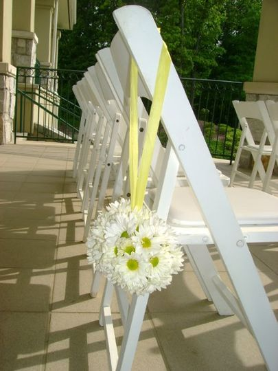 These can hang down the aisle from the chairs or on shephard's hooks and can be done in a variety of...