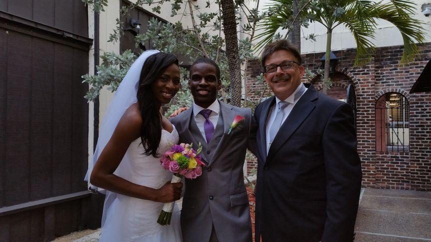 Bride, groom, wedding officiant