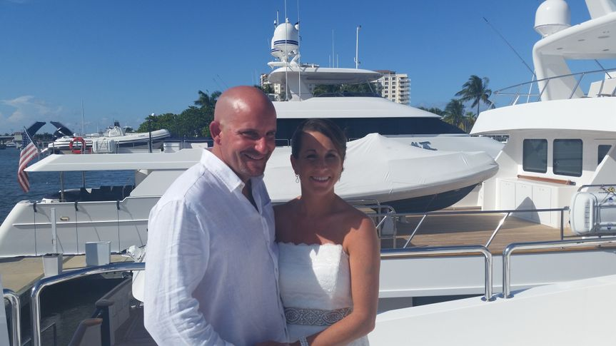 Newlyweds by the yacht