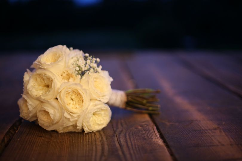 Who doesn't love a simple white rose bouquet