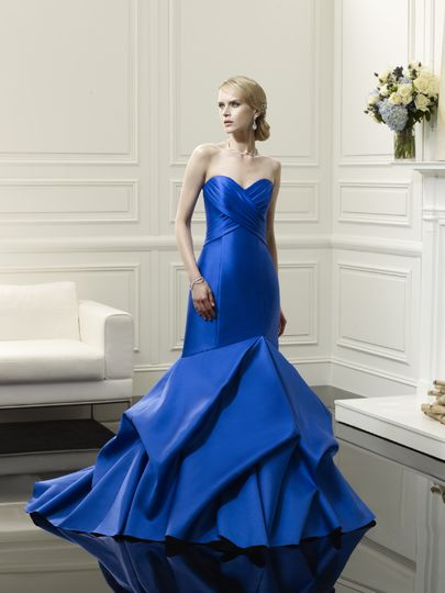 D8051  This gown is a fresh take on something blue and creates a figure flattering design. Soft...