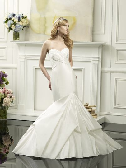 D8052  Architecturally designed with feminine curves in mind, this silk shantung mermaid silhouette...