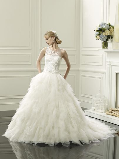 D8053  This gown has a flattering sheer detachable bateau build-up adorned with rich embroidery and...