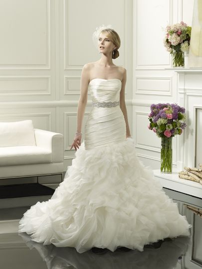 D8054  The fitted, strapless bodice softly dips into a sweetheart neckline and is ruched...